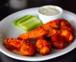 Buffalo Wings - 10 chicken wings in buffalo sauce, celery & blue cheese dressing