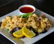 Crispy Calamari - fried calamari served with marinara or spicy Thai sauces